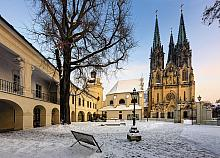 A cluster of heritage monuments on Wenceslas Square – Archdiocesan Museum, Chapel of St. Barbara, Chapel of St. Anne, part of Zdík Palace, and ...